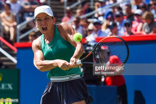 Simona Halep returns the ball during the WTA Coupe Rogers final on August 12, 2018 at IGA Stadium in Montréal, QC