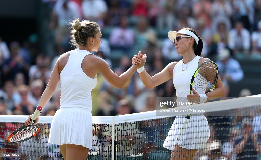 Simona Halep shakes hands with Saisai Zheng (right) after her win on day four of the Wimbledon Championships at the All England Lawn Tennis and Croquet Club, Wimbledon.