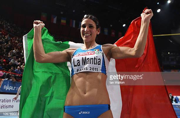 Simona La Mantia of Italy celebrates winning the gold medal in the Women's Triple Jump during day 2 of the 31st European Athletics Indoor...