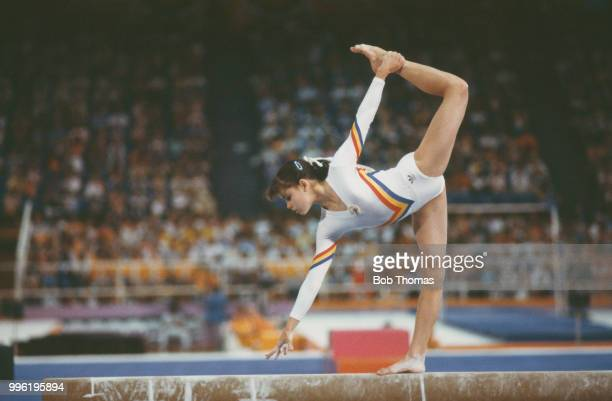 Simona Pauca of Romania competes in the women's balance beam competition of the artistic gymnastics events at the 1984 Summer Olympics in Los Angeles...