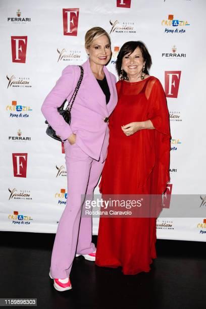 Simona Ventura and Marisa Deimichei attend the F Magazine Party at Filippo La Mantia Oste e Cuoco restaurant on July 03, 2019 in Milan, Italy.