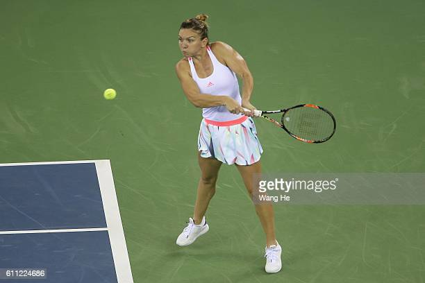 Simonaa Halep of Romania returns a shot during the match against Madison Keys of USA on Day 5 of the 2016 Dongfeng Motor Wuhan Open at the Optics...