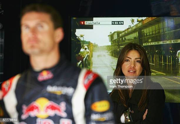 Simone Abdelnour watches boyfriend David Coulthard of Great Britain during qualifying for the Australian Formula One Grand Prix at Albert Park on...
