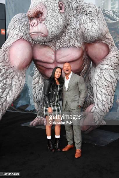 Simone Alexandra Johnson and Dwayne Johnson attend the premiere of Warner Bros Pictures' 'Rampage' at Microsoft Theater on April 4 2018 in Los...