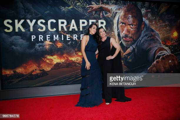 Simone Alexandra Johnson and he rmother producer Dany Garcia attend the premiere of 'Skyscraper' on July 10 2018 in New York City