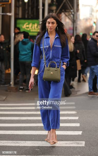 Simone Aptekman is seen Wearing Christian Dior shoesbag by Chanel and vintage automotive Jumpsuit on February 28 2018 in New York City