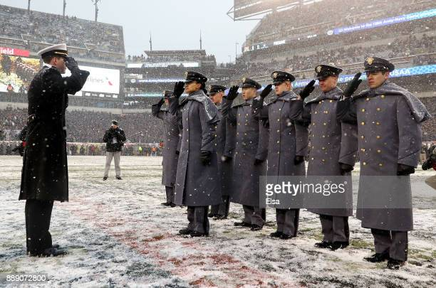 Simone Askew first captain of the Corps of Cadets accepts the Army prisoners from the Navy before the game between the Army Black Knights and the...