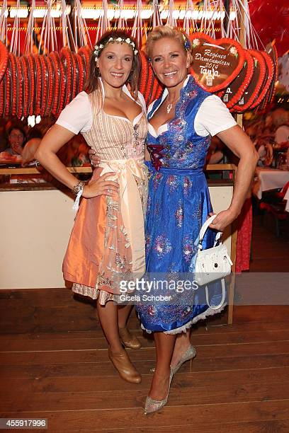 Simone Ballack and Claudia Effenberg attend the 'Sixt Damen Wiesn' at Marstall tent during Oktoberfest at Theresienwiese on September 22, 2014 in...