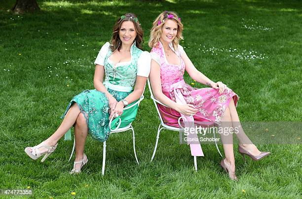Simone Ballack and Monica Ivancan wearing dirndl by Astrid Soell and hair accesssoires by 'Schoenmich' pose during a photo session on May 11 2015 in...