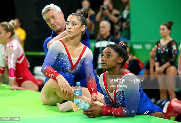 Simone Biles and Alexandra Raisman of the United States watch Vanessa Ferrari of Italy competing on the Women's Floor Final on Day 11 of the Rio 2016...