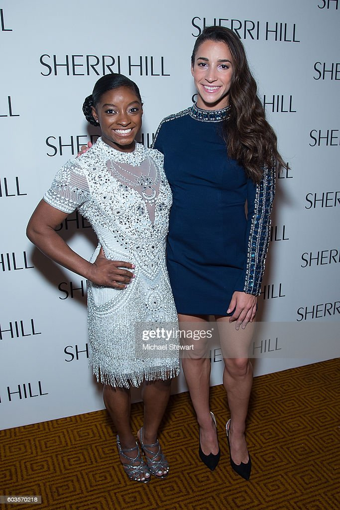 Simone Biles (L) and Aly Raisman attend the Sherri Hill fashion show during September 2016 New York Fashion Week: The Shows at Gotham Hall on September 12, 2016 in New York City.