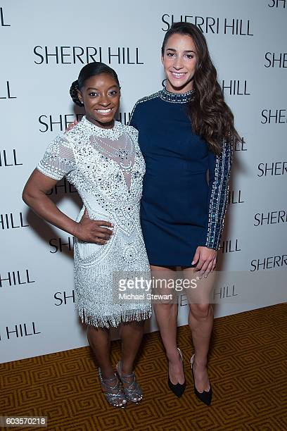 Simone Biles and Aly Raisman attend the Sherri Hill fashion show during September 2016 New York Fashion Week The Shows at Gotham Hall on September 12...