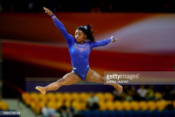 Simone Biles competes in the women's balance beam qualification during day three of the 2018 FIG Artistic Gymnastics Championships at Aspire Dome on...