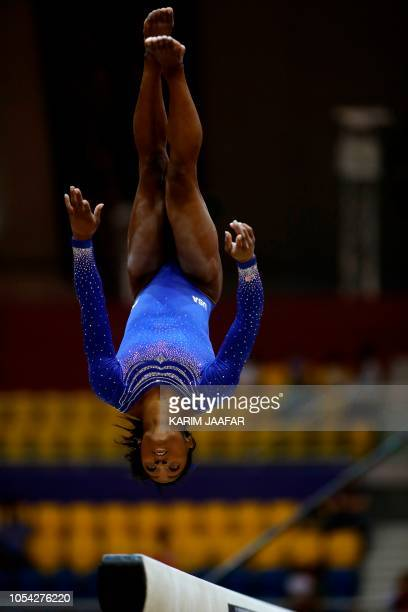 US Simone Biles competes in the women's balance beam qualification during day three of the 2018 FIG Artistic Gymnastics Championships at Aspire Dome...