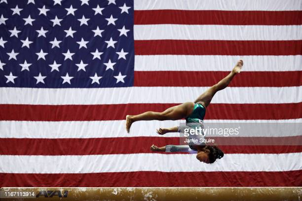 Simone Biles competes on the balance beam during the Senior Women's competition of the 2019 U.S. Gymnastics Championships at the Sprint Center on...