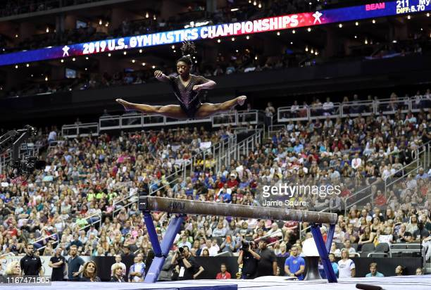 Simone Biles competes on the balance beam during Women's Senior competition of the 2019 U.S. Gymnastics Championships at the Sprint Center on August...