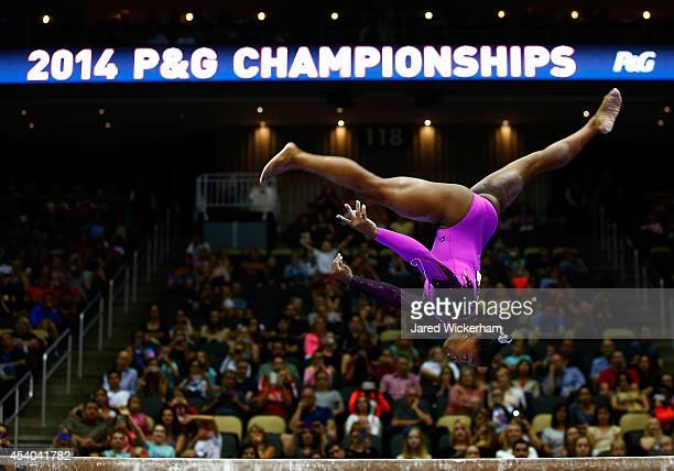 Simone Biles competes on the balance beam in the senior women finals during the 2014 PG Gymnastics Championships at Consol Energy Center on August 23...