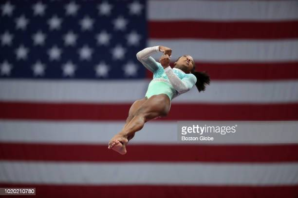 Simone Biles competes on the vault at the US senior women's final round of competition at the US Gymnastics Championships at TD Garden in Boston on...