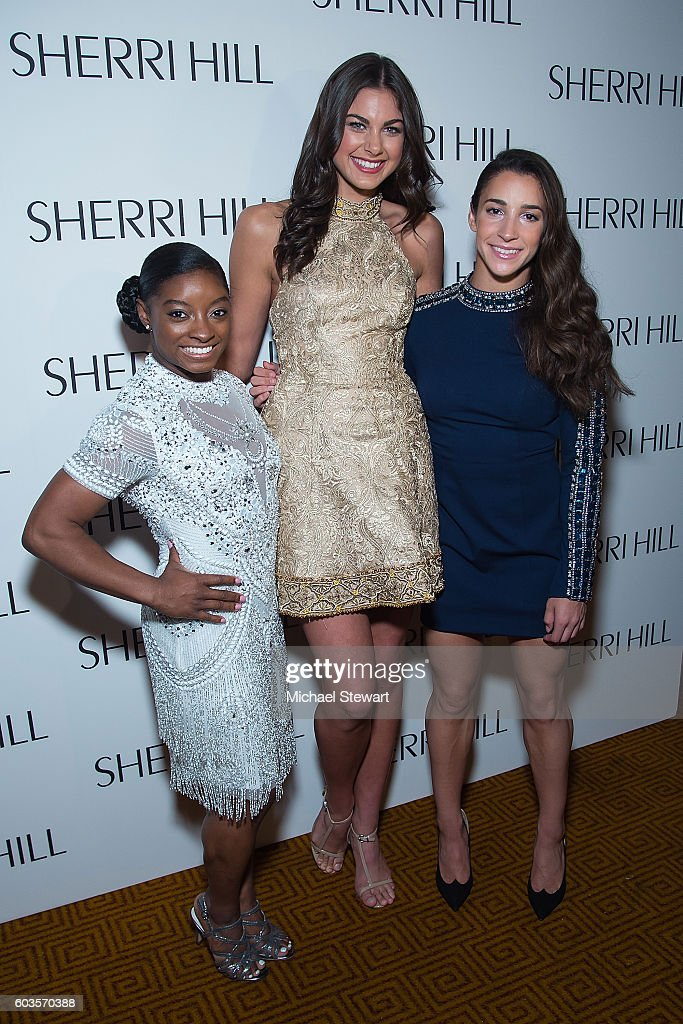 Simone Biles, Miss Teen USA 2015 Katherine Haik and Aly Raisman attend the Sherri Hill fashion show during September 2016 New York Fashion Week: The Shows at Gotham Hall on September 12, 2016 in New York City.