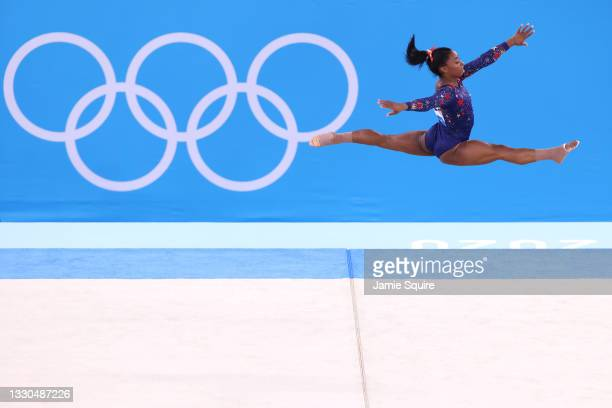Simone Biles of Team United States competes in the floor exercise during Women's Qualification on day two of the Tokyo 2020 Olympic Games at Ariake...