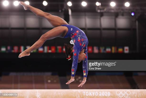 Simone Biles of Team United States competes on balance beam during Women's Qualification on day two of the Tokyo 2020 Olympic Games at Ariake...