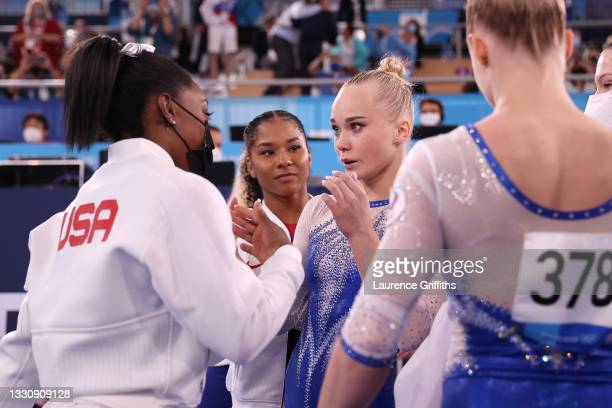 Simone Biles of Team United States congratulates Team ROC on their gold medal win during the Women's Team Final on day four of the Tokyo 2020 Olympic...