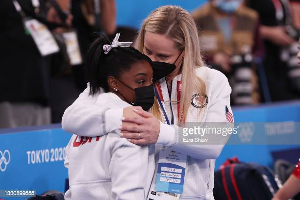 Simone Biles of Team United States is embraced by coach Cecile Landi during the Women's Team Final on day four of the Tokyo 2020 Olympic Games at...