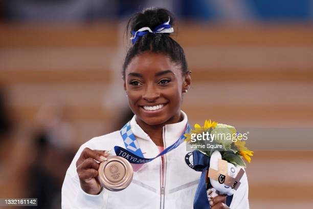 Simone Biles of Team United States poses with the bronze medal during the Women's Balance Beam Final medal ceremony on day eleven of the Tokyo 2020...