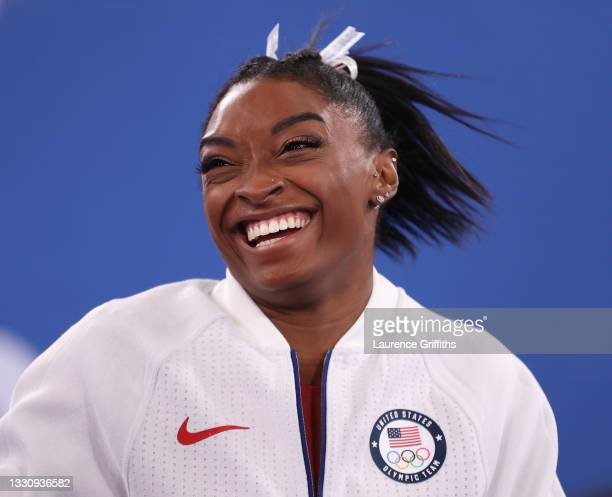 Simone Biles of Team United States reacts during the Women's Team Final on day four on day four of the Tokyo 2020 Olympic Games at Ariake Gymnastics...
