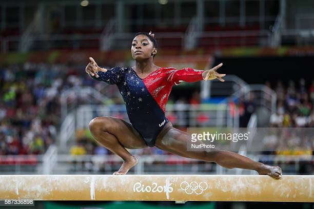Simone Biles of the United States acts during women's qualification match of balance Beam of Artistic Gymnastics at the 2016 Rio Olympic Games in Rio...