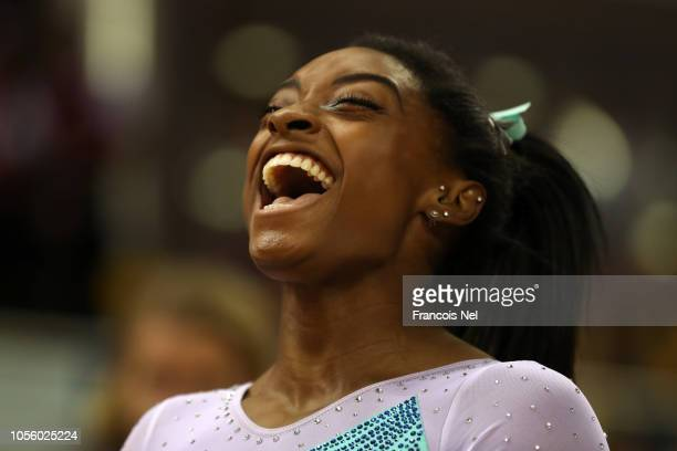 Simone Biles of the United States celebrates after winning Women's AllAround Final during Day Eight of 2018 FIG Artistic Gymnastics Championships at...