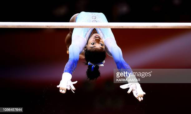 TOPSHOT Simone Biles of the United States competes on the uneven bars during day nine of the 2018 FIG Artistic Gymnastics Championships at the Aspire...