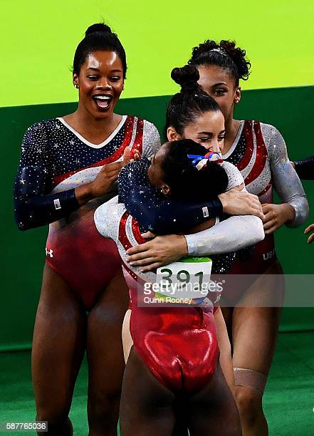 Simone Biles of the United States is congratulated by her team mates on the floor during the Artistic Gymnastics Women's Team Final on Day 4 of the...