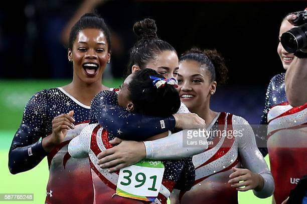 Simone Biles of the United States is congratulated by her team mates after competing on the floor during the Artistic Gymnastics Women's Team Final...