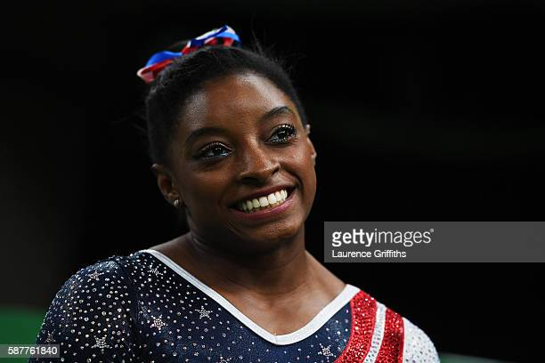 Simone Biles of the United States looks on during the Artistic Gymnastics Women's Team Final on Day 4 of the Rio 2016 Olympic Games at the Rio...