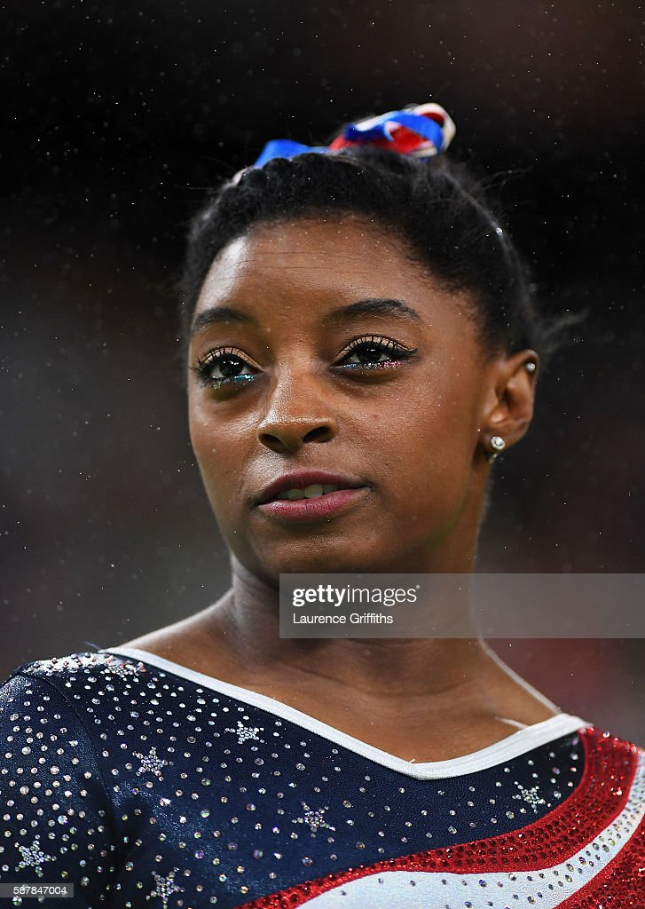 Simone Biles of the United States looks on during the Artistic Gymnastics Women's Team Final on Day 4 of the Rio 2016 Olympic Games at the Rio Olympic Arena on August 9, 2016 in Rio de Janeiro, Brazil.
