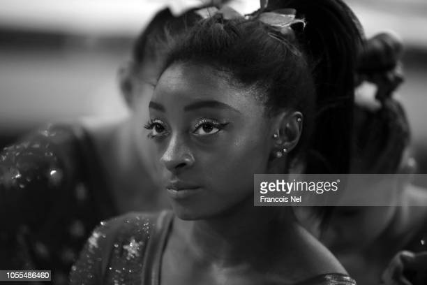 Simone Biles of The United States looks on during the Women's team final during day six of the 2018 FIG Artistic Gymnastics Championships at Aspire...