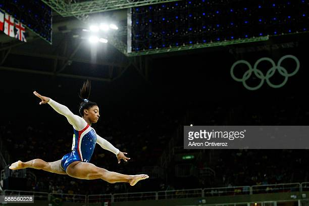 Simone Biles of the United States performs on the beam during the women's individual allaround at Rio 2016 on Thursday August 11 2016 Biles captured...