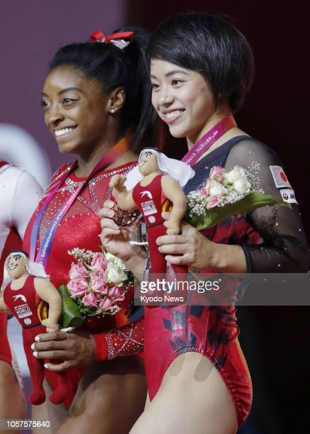 Simone Biles of the United States poses after winning the women's floor exercise at the artistic gymnastics world championships in Doha on Nov 3...
