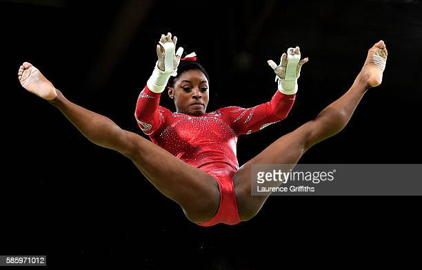 Simone Biles of the United States practices on the uneven bars during an artistic gymnastics training session on August 4 2016 at the Arena Olimpica...