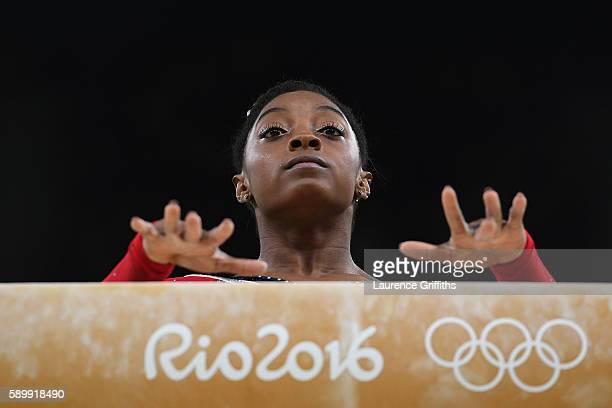 Simone Biles of the United States prepares to compete in the Balance Beam Final on day 10 of the Rio 2016 Olympic Games at Rio Olympic Arena on...