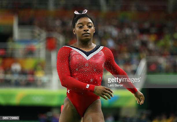 Simone Biles of the United States reacts after competing in the Balance Beam Final on day 10 of the Rio 2016 Olympic Games at Rio Olympic Arena on...