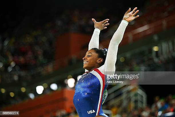 Simone Biles of the United States reacts after competing on the balance beam during the Women's Individual All Around Final on Day 6 of the 2016 Rio...