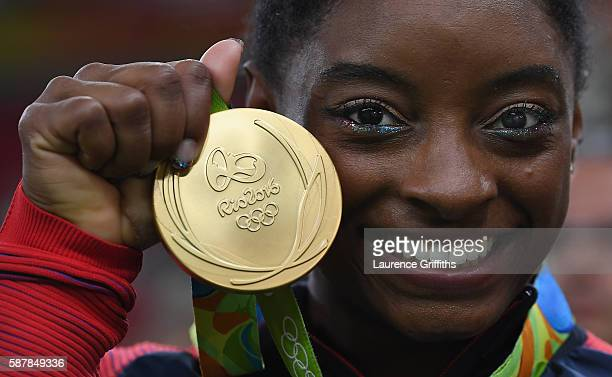Simone Biles of the United States shows of her Gold medal after the Artistic Gymnastics Women's Team Final on Day 4 on Day 4 of the Rio 2016 Olympic...