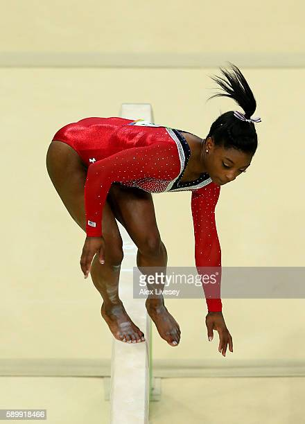 Simone Biles of the United States slips while competing in the Balance Beam Final on day 10 of the Rio 2016 Olympic Games at Rio Olympic Arena on...