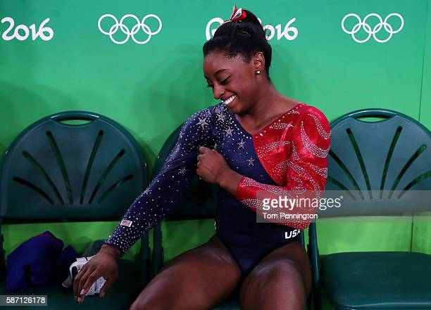Simone Biles of the United States smiles after the vault apparatus during Women's qualification for Artistic Gymnastics on Day 2 of the Rio 2016...
