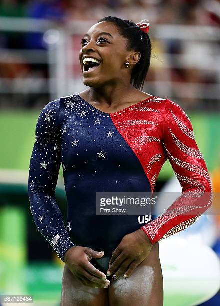 Simone Biles of the United States smiles before competing on balance beam during Women's qualification for Artistic Gymnastics on Day 2 of the Rio...