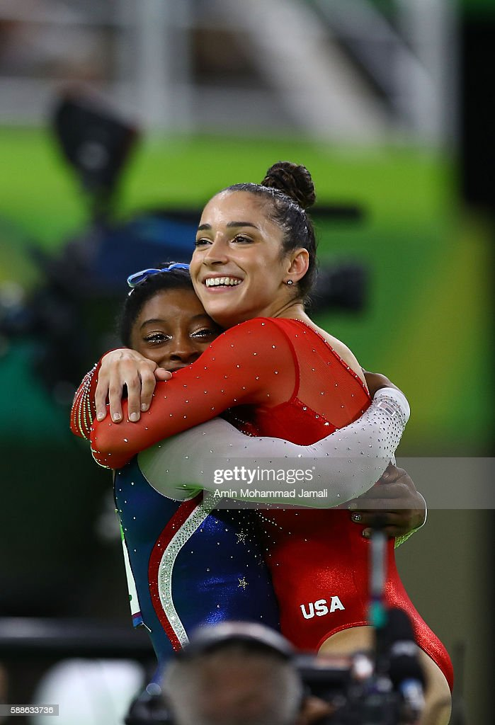 Simone Biles (L) of the United States waits for the score after competing on the floor with Alexandra Raisman (R) during the Women's Individual All Around Final on Day 6 of the 2016 Rio Olympics at Rio Olympic Arena on August 11, 2016 in Rio de Janeiro, Brazil.
