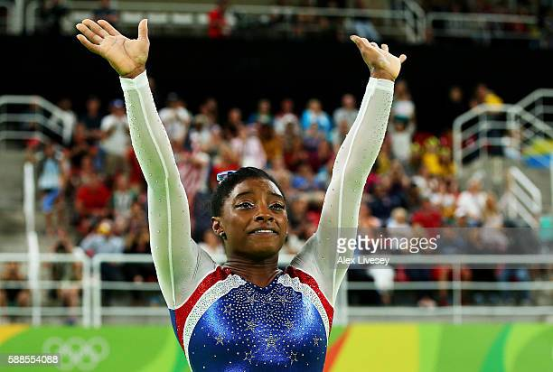 Simone Biles of the United States waves to fans after winning the gold medal during the Women's Individual All Around Final on Day 6 of the 2016 Rio...
