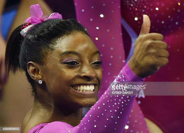 Simone Biles of the US gives the thumbs up to supporters after winning the women's allaround final at the Gymnastics World Championships in Nanning...